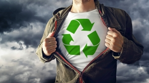 Man stretching jacket to reveal shirt with recycle symbol printed. Concept of environmental conciousness and natural preservation.